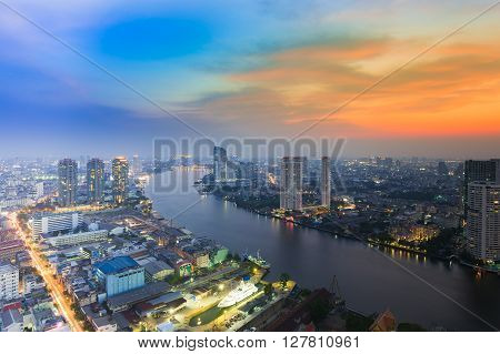 Aerial view River curved in city downtown during sunset, Bangkok Thailand