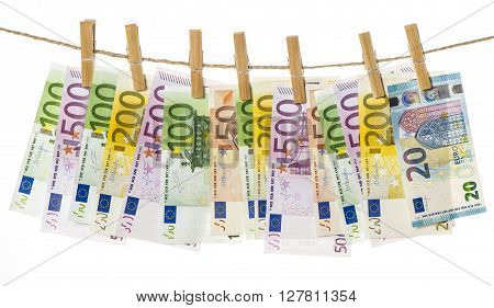 Money background. Euro banknotes hanging a rope with clothes pins