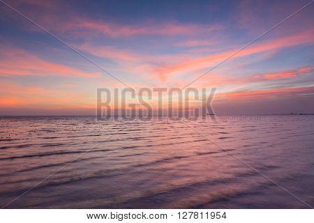 Beauty sky after sunset over seacoast skyline, natural landscape background