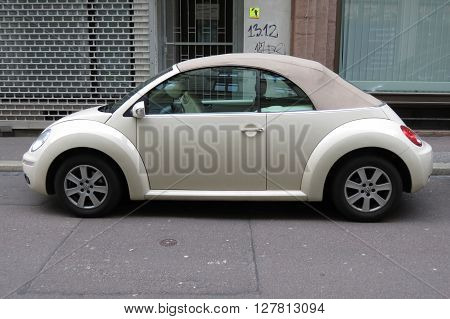 HALLE (SAALE) GERMANY - CIRCA MARCH 2016: off white Volkswagen New Beetle cabrio car parked in a street of the city centre
