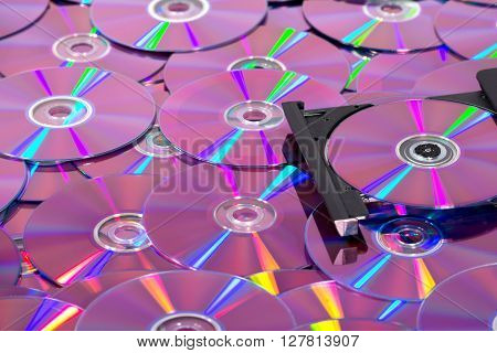 A lot of compact discs (cd and dvd) and a portable slim external - CD DVD burner
