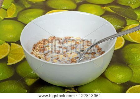 Muesli with a mix of healthy fruit nuts and seeds and milk in a dish.