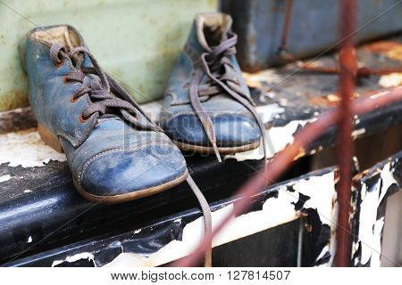 Old and dirty blue shoes with shoelaces