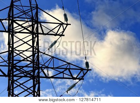 transmission line on background of blue sky and clouds