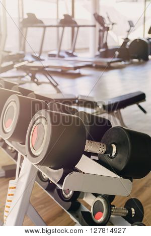 row of dumbbells in sport club Gym interior