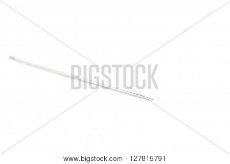 Small needle mettal isolated over the white background