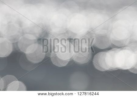 Light silver abstract bogey lights background. Glowing magic bokeh