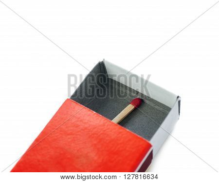 One Wooden unused match in box isolated over the white background