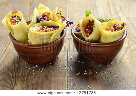 Tortilla wraps with vegetables and tomato sauce