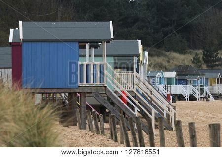 beach huts along the coastline of norfolk
