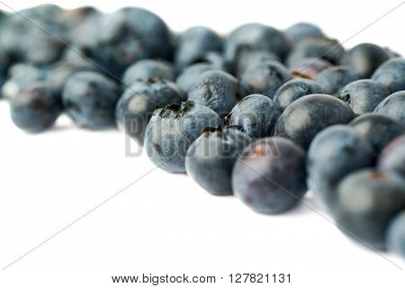 Ripe bilberry or blueberry over isolated white background