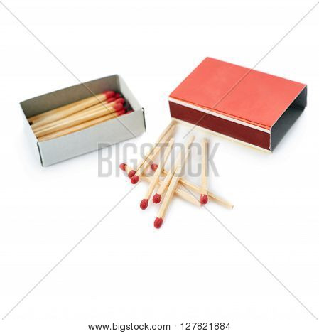 Pile of Wooden unused matches with box isolated over the white background