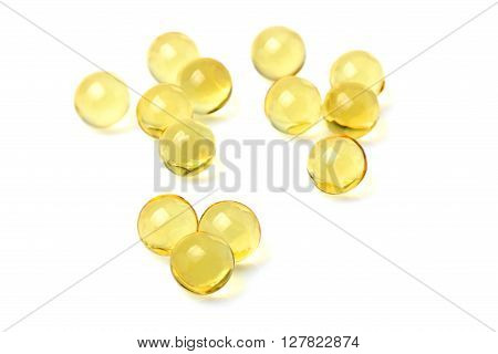 Fish oil capsules isolated on white background.