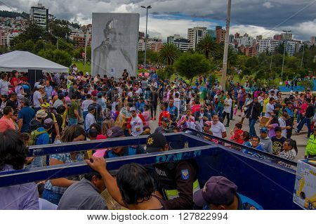 Quito, Ecuador - April, 17, 2016: Unidentified volunteers of Quito providing disaster relief food, clothes, medicine and water for earthquake survivors in the coast.