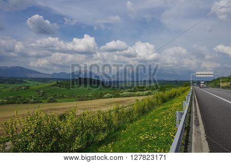 Highway In Slovakia. Meadows And High Tatras Peaks Panorama On Background. Presov Region, Slovakia.