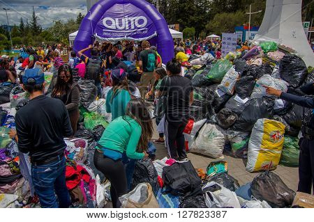 Quito, Ecuador - April, 17, 2016: Unidentified citizens of Quito providing disaster relief food, clothes, medicine and water for earthquake survivors in the coast. Gathered at la Caolina Park.