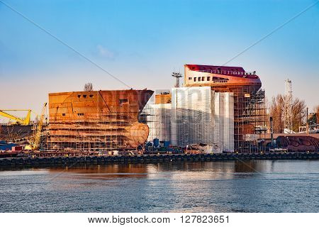 Hull of ship under construction at shipyard.