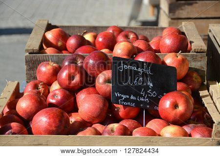 Red Apples in crates on French market stall