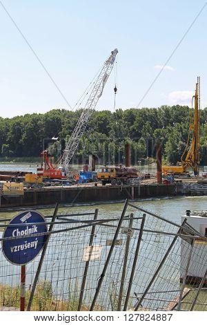 BRATISLAVA SLOVAKIA - JULY 10: New Bridge Construction in Bratislava on JULY 10 2015. Construction Site of Steel Bridge Over Danube River in Bratislava Slovakia.