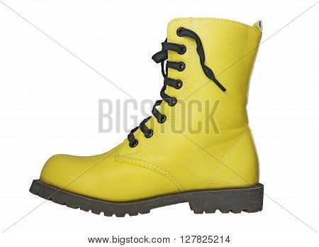 High yellow boot with black laces on a white background