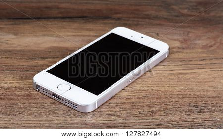 Minsk, Belarus - April 16, 2016: Apple iPhone 5, 5S. White version. Front view. The operating system iOS 9. The founders of the company: Steve Jobs, Ronald Wayne, Steve Wozniak. Apple Inc. Located in USA.