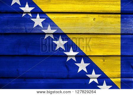Flag Of Bosnia And Herzegovina, Painted On Old Wood Plank Background