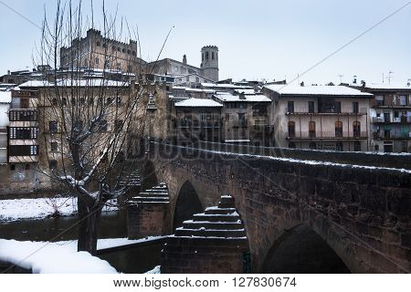 VALDERROBRES. FEBRUARY 27 2016: View of the medieval Village in Teruel province with the first snow. Medieval bridge and Calatravo Castel in Vaderrobres on february 27, 2016