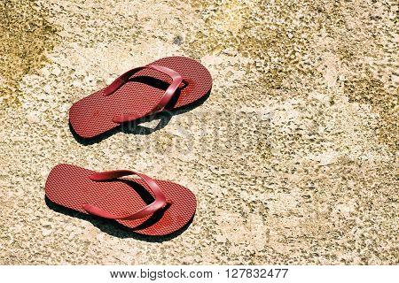 Red Sandals On Wet Floor