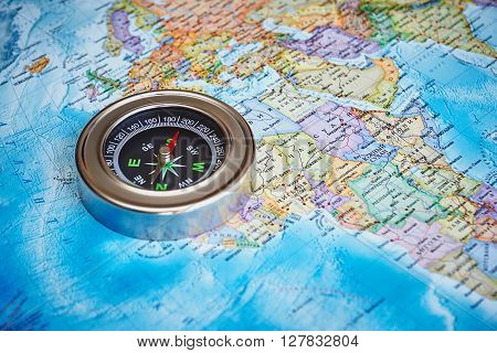 The magnetic compass is located on a topographic map