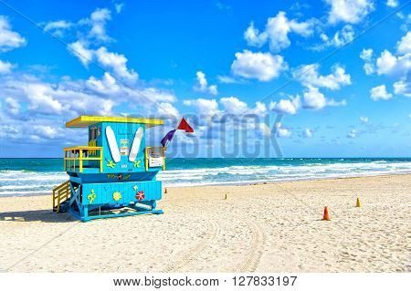 South Beach Miami Florida lifeguard house in a colorful Art Deco style on cloudy blue sky and Atlantic Ocean in background world famous travel location