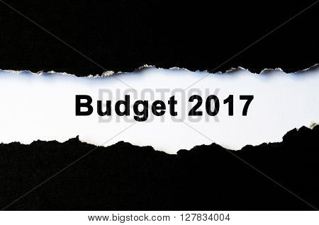 Budget 2017 text under torn black paper