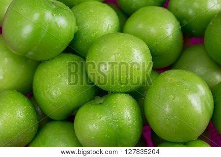 Fresh green plums close-up. Green plums close-up.