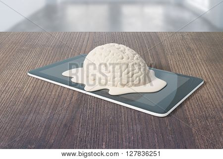 Mental degradation concept with brain melting on tablet placed on dark wooden desktop. 3D Rendering