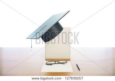 Graduation concept with book graduation cap glasses and paper on wooden desktop. 3D Rendering