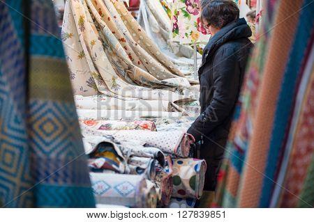 Woman Choosing Textile
