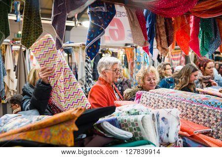 Womens Buying Fabrics At Market