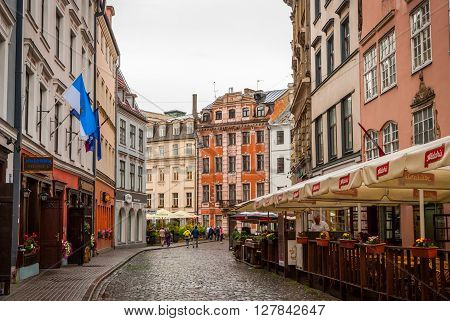 View On Riga Downtown With Tourists In Cafe