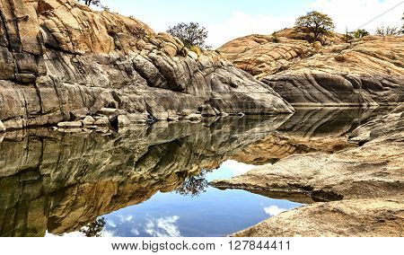 professional high resolution landscape photograph of a scenic granite mountain lake showing classic composition and lighting fundamentals and non intrusive post processing techniques