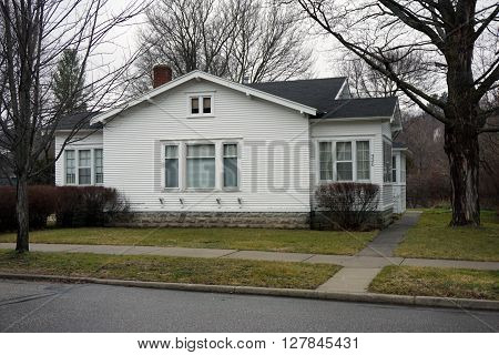 HARBOR SPRINGS, MICHIGAN / UNITED STATES - DECEMBER 23, 2015: A white home on Second Street in Harbor Springs.