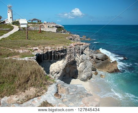 Small Mexican island named Isla Mujeres at the Acantilado del Amanecer (Cliffs of the Dawn) at the Punta Sur (south point) across from Cancun Mexico