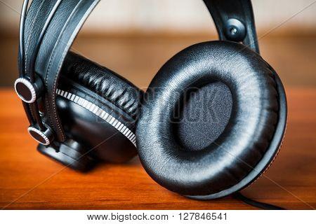 Professional studio headphones closeup. Very shallow depth of field