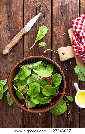 fresh chard leaves on a wooden table