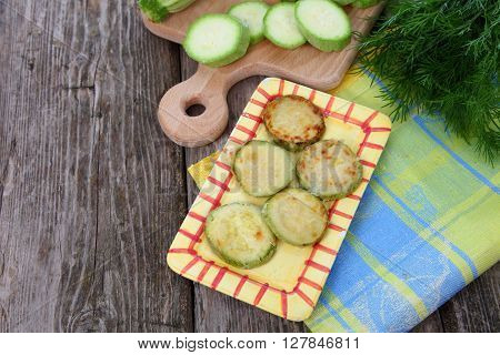 Fried Zucchini In A Yellow Plate