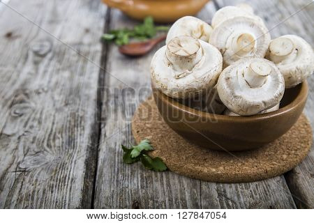 Raw Mushrooms In A Bowl On A Table