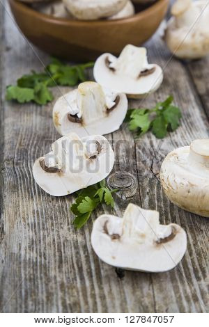 Raw Mushrooms On A Wooden Table