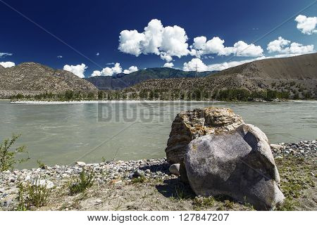 view from mountain river mountain and sky with clouds
