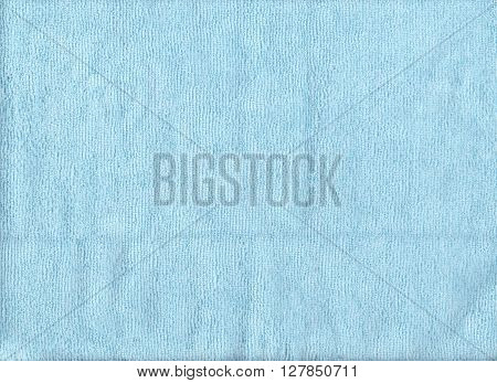 Texture of blue microfiber cloth for design background.