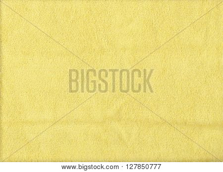 Texture of yellow microfiber cloth for design background.