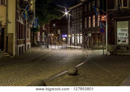 Maastricht, Netherlands - May 15: This is one of the streets of the old part of the city at night May 15, 2015 in Maastricht, Netherlands.