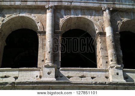 In this picture a close detail of the archs of the majestic Colosseum in Rome